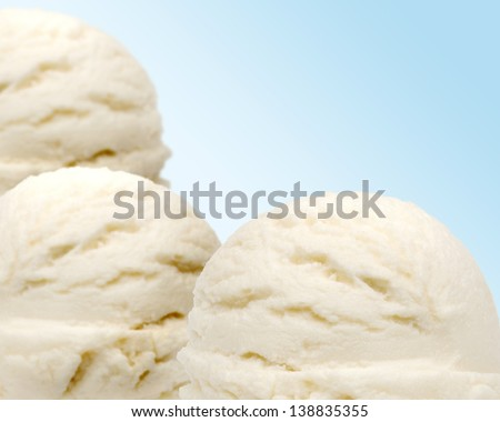 Three scoops of vanilla ice cream with shallow depth of field