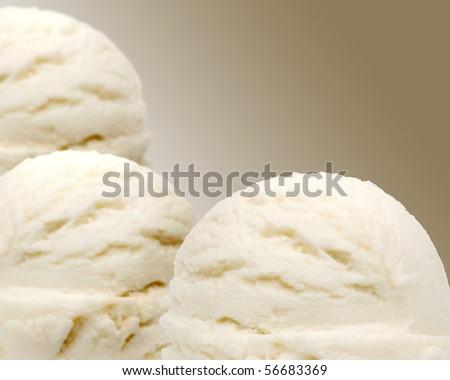 Three scoops of vanilla ice creams with bokeh - stock photo