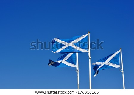 Three Scotland or Scottish flags, known as the saltire or St Andrew's cross. - stock photo