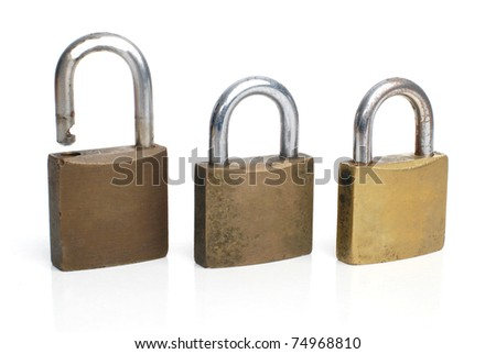 Three security gold locks in a row isolated on white background