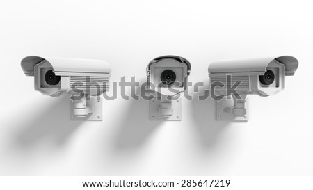 Three security surveillance cameras isolated on white background - stock photo