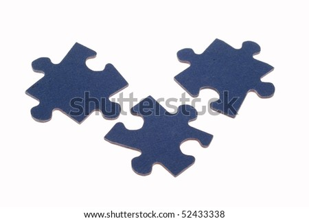 Three separated, fitting, blue, jigsaw puzzle pieces against a white background. - stock photo