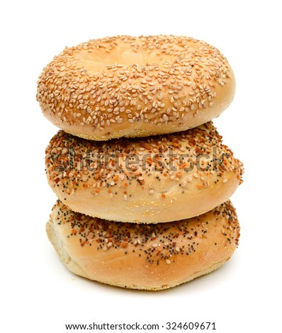 three sesame bagels isolated on white
