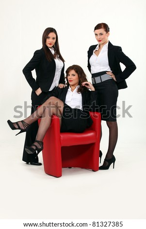 three sexy woman in a suit