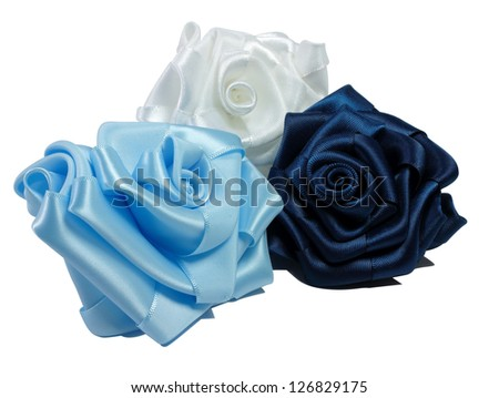 Three silk roses blue, blue and white are on a white background - stock photo