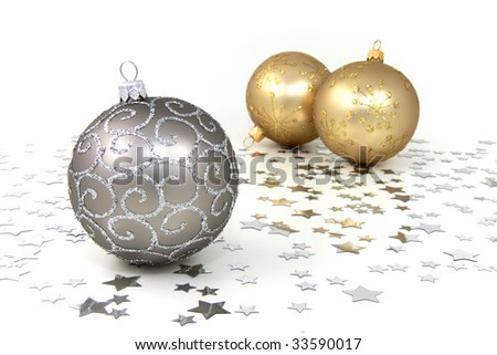 Three silver and golden christmas baubles with silver stars on white background - stock photo