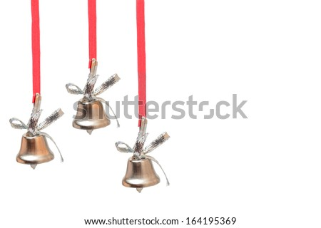 three silver bells on red ribbons on white background - stock photo
