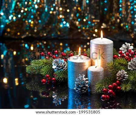 Three Silver Candles with Christmas tree branches and Xmas decoration - stock photo