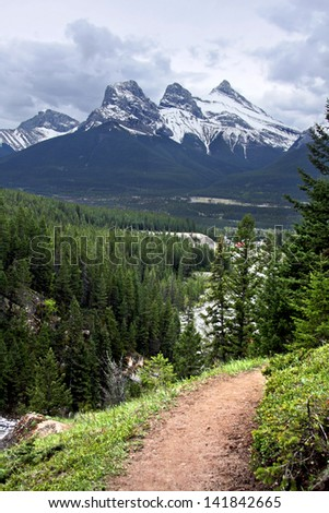 Three Sister Mountains, Canmore, Alberta, Canada  Picture taken on the hike up Mount Lady MacDonald. - stock photo