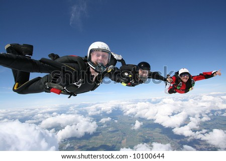 Three Skydivers form a line - stock photo