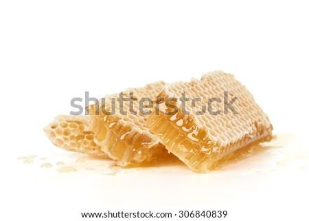 Three slices of honeycomb isolated on white                          - stock photo