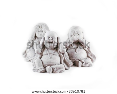 Three small japanese statues on a white background