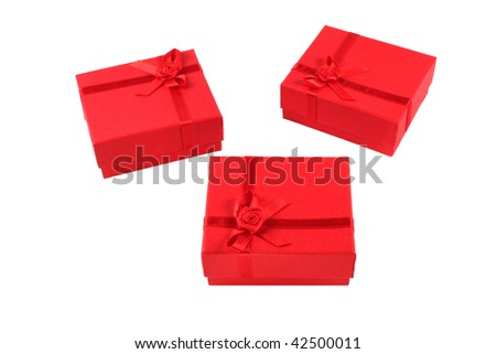 Three, small, red gift boxes isolated on white