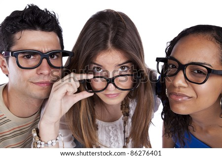 Three smart student friends looking with eyeglasses - stock photo