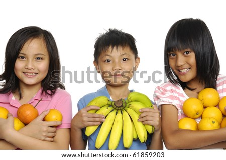 Three smile friends holding fruit - stock photo