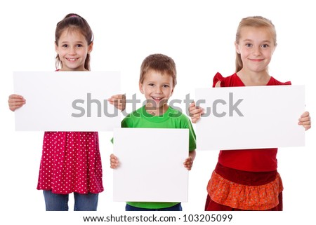 Three smiling kids standing with empty blank in hands, isolated on white