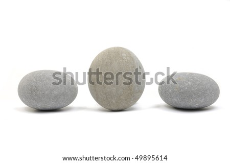 Three smooth stones on white