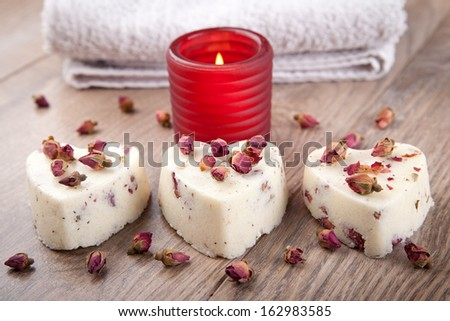 Three soap pralines in a heart shape - stock photo