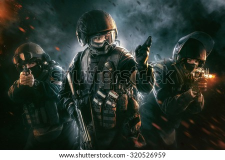 Three soldiers in full uniform with guns is going to attack. Uniform conforms to special services FSB (soldiers) of the Russian Federation. Shot in studio. Explosion on a black background - stock photo
