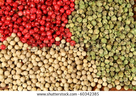 Three sorts of pepper: white, green and red - stock photo