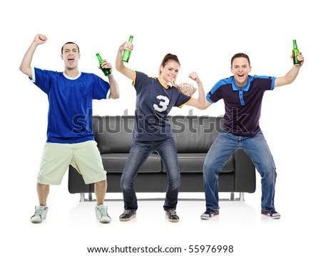 Three sport fans celebrating the victory - stock photo