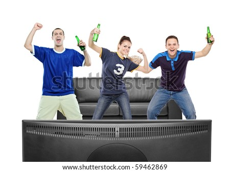 Three sport fans watching TV against white background - stock photo
