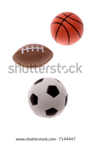 Three sports balls over white