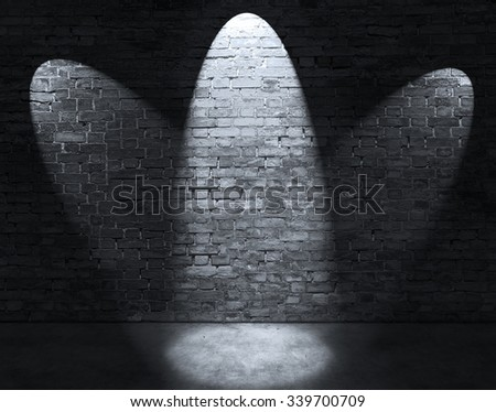 Three spot lights on old brick wall