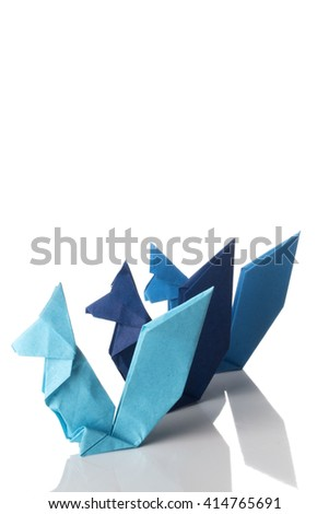 Three squirrels origami made of blue paper isolated on white background.