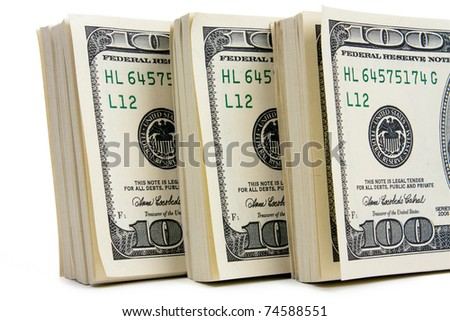 Three stack of $100 bills isolated on white background. Closeup - stock photo