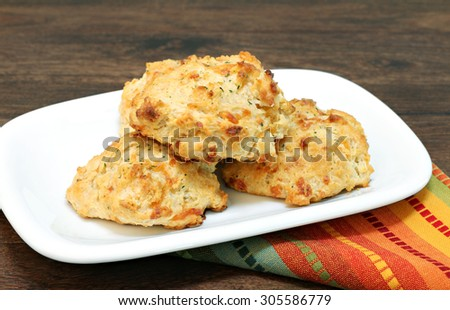 Three stacked cheddar, parsley and garlic biscuits. - stock photo