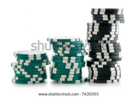 Three stacks of casino chips in a row isolated over a white background.