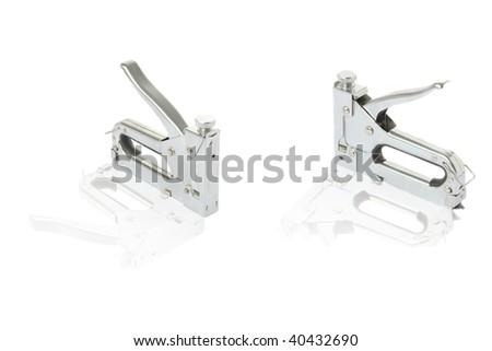 three staple guns at white; background - stock photo