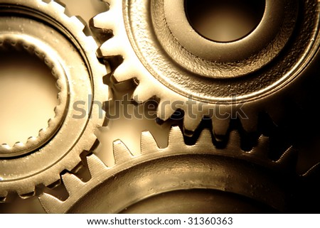 Three steel gears joining together - stock photo
