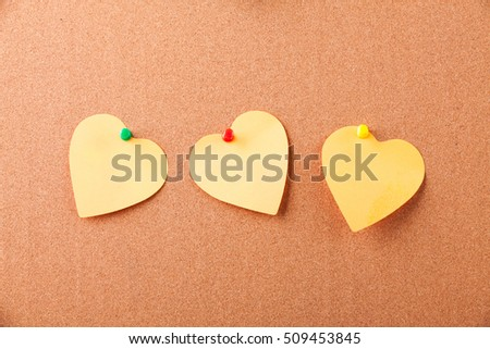 three sticker - heart on cork background