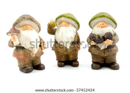 three stone autumn statue dolls of gnome isolated on white background - stock photo