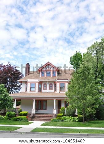 Three Story Victorian Style Home Front Yard Sidewalk Curb Street Residential Suburban Neighborhood - stock photo