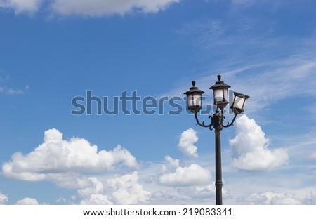 Three streetlights/street lamps at sunrise - stock photo