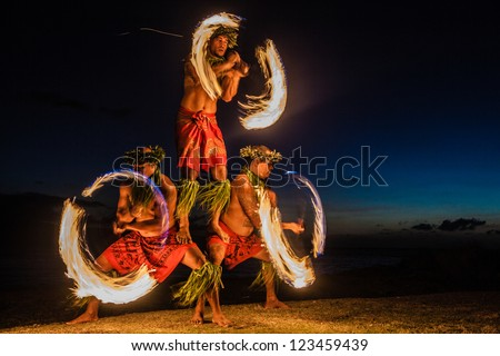 Three Strong Men Juggling Fire in Hawaii - Fire Dancers - stock photo
