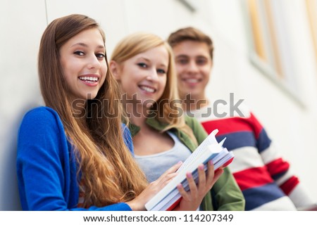 Three students - stock photo