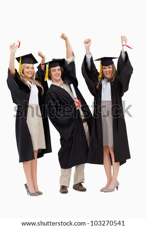 Three students in graduate robe raising their arms against white background