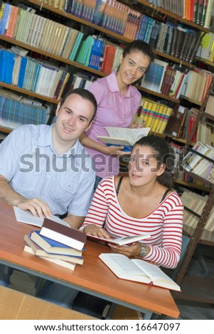 Three students in library