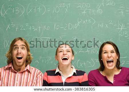 Three students laughing - stock photo
