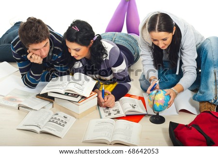 Three students meeting in a house to studying together and doing there homework on wooden floor