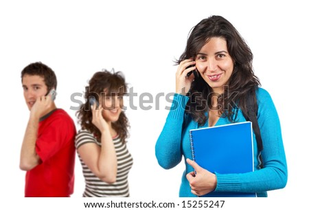 Three students talking with phone over a white background. Focus at front - stock photo