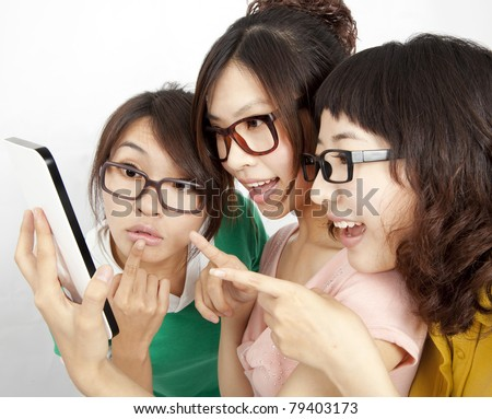 three Students with touch screen tablet computer - stock photo
