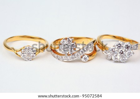 Three style of golden rings with diamond isolated on white background.