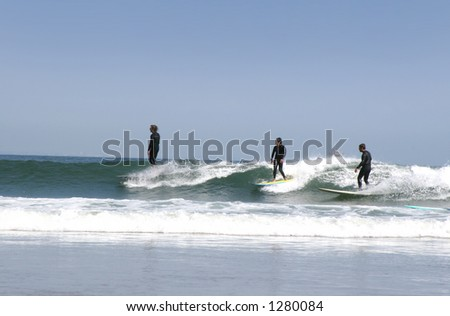 three surfers - stock photo