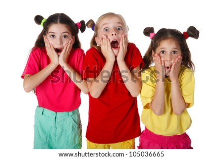Three surprised little girls, isolated on white - stock photo