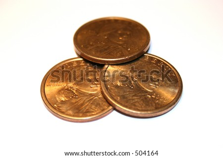 Three Susan B Anthony Coins, focused on the intersection in the middle. - stock photo